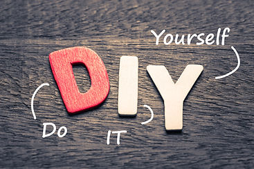 Wood letters of DIY and definition on wo