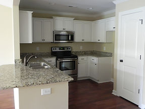new townhomes with granite, beautiful cabinetry, hardwood floors