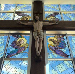 Crucifix and stained glass crucifixion window