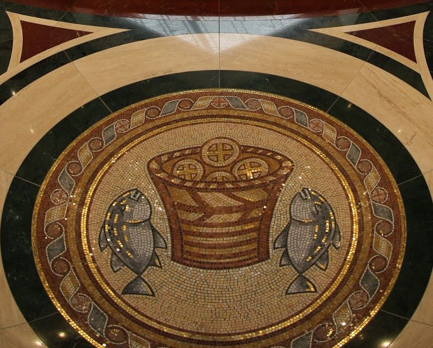 Center aisle detail of liturgical symbols