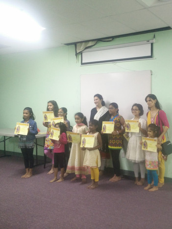Happy faces after receiving their certificates of completion!