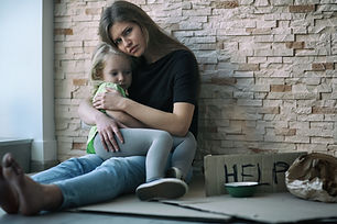 Homeless poor woman and her little daugh