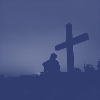 silhouette of man standing near cross during sunset_edited.jpg