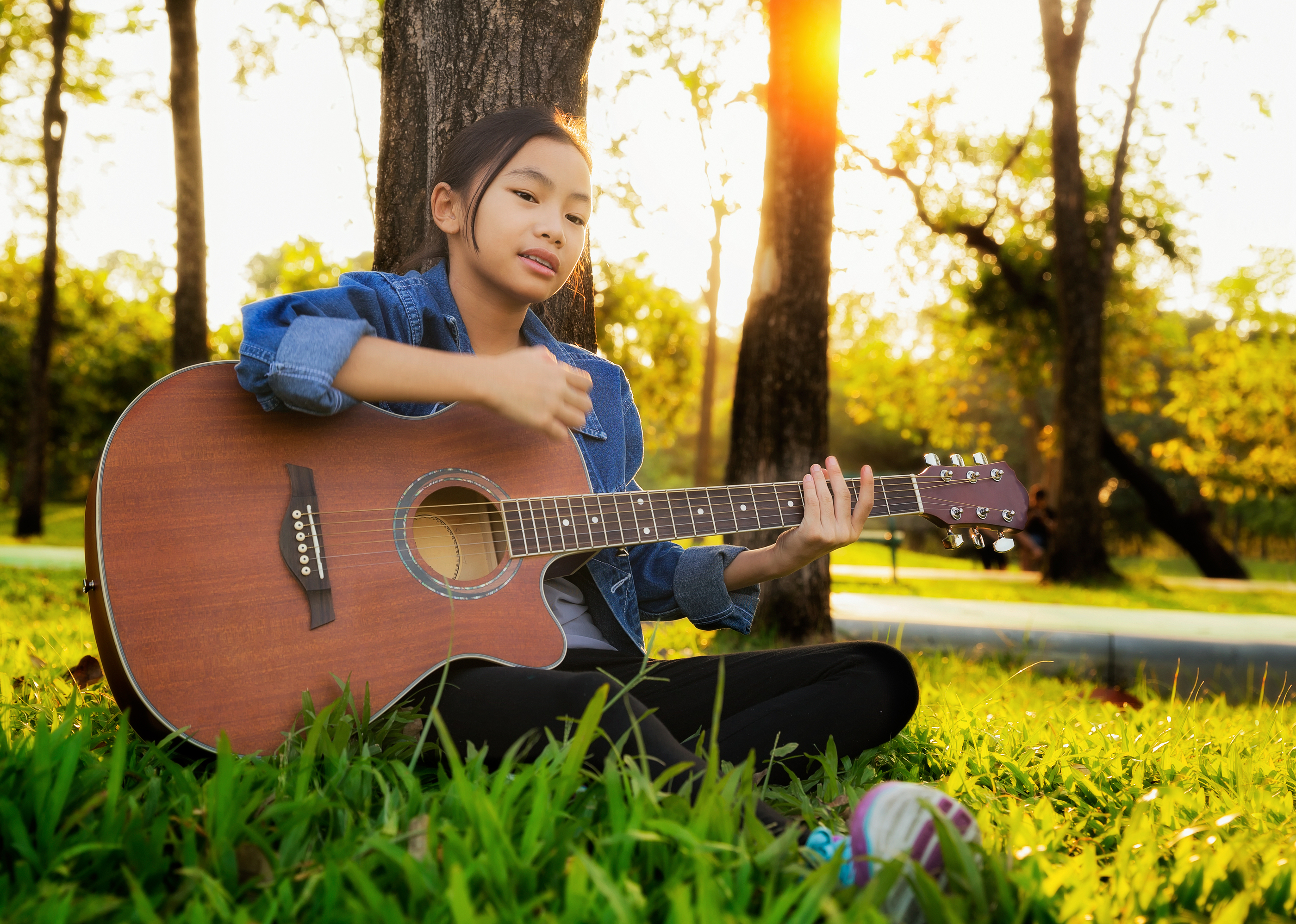 Tween girl playing guitar