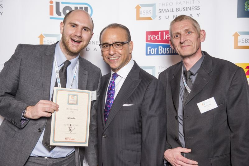 Our Managing Director Kurt Davis and Head of Operations Steve Parker are shaking hands with Theo Paphitis.
