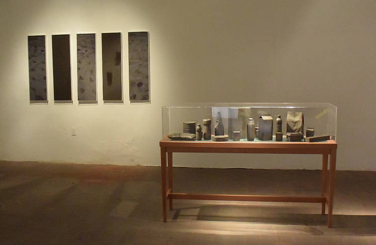 Fraking, 2015.  Wall panels with photograhs an soil.  39.37 x 11.81 inches each. 100 x 30 cm. each. Museum of the Ministry  of Foreign Affairs/ Mexico Collection.  Timeless state of food, 2014 18 reproductions of food containers in bronze, wood table and acrylic cover. 43.30 x 62.99 x 15.74 inches 110 x 160 x 40 cm.