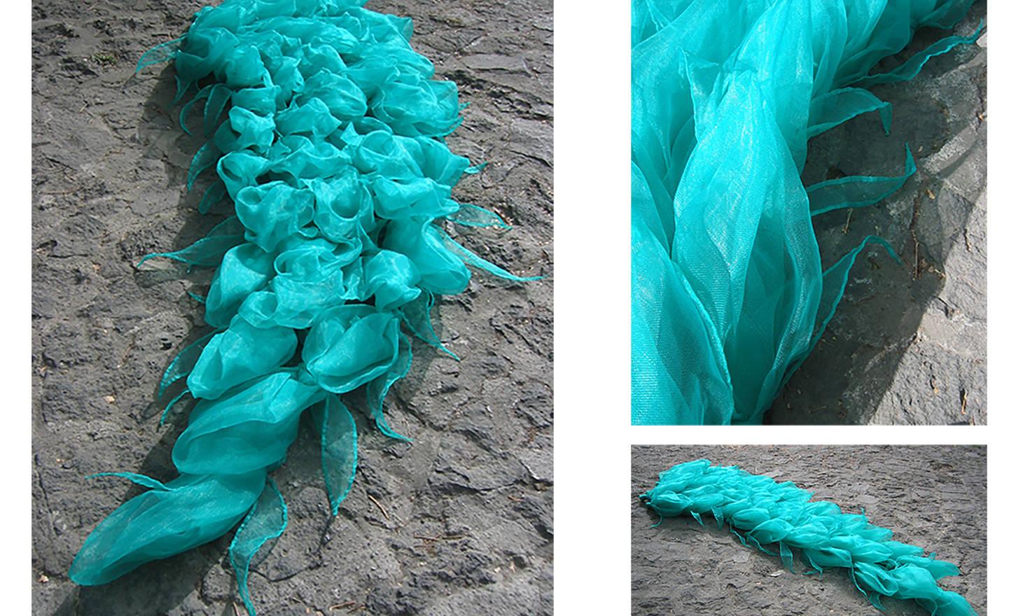 Hypertropic, 2007 Plastic mesh and fishing thread. 23.62 x 11.81 x 120.07 inches. 60 x 30 x 305 cm.