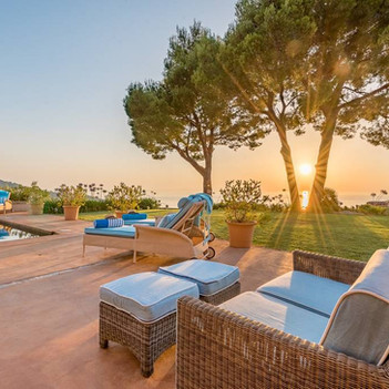 Sunset and sunloungers