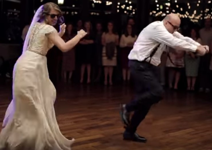 Dad and daughter dance at wedding reception to DJ music.