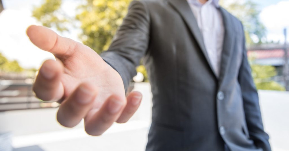 Man reaching out to extend a helping hand