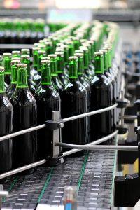 wine on fast moving bottling line