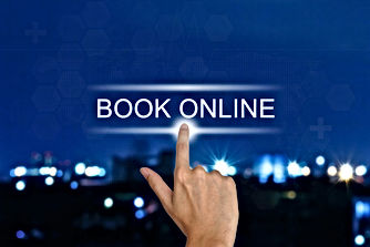 hand clicking book online button on a to