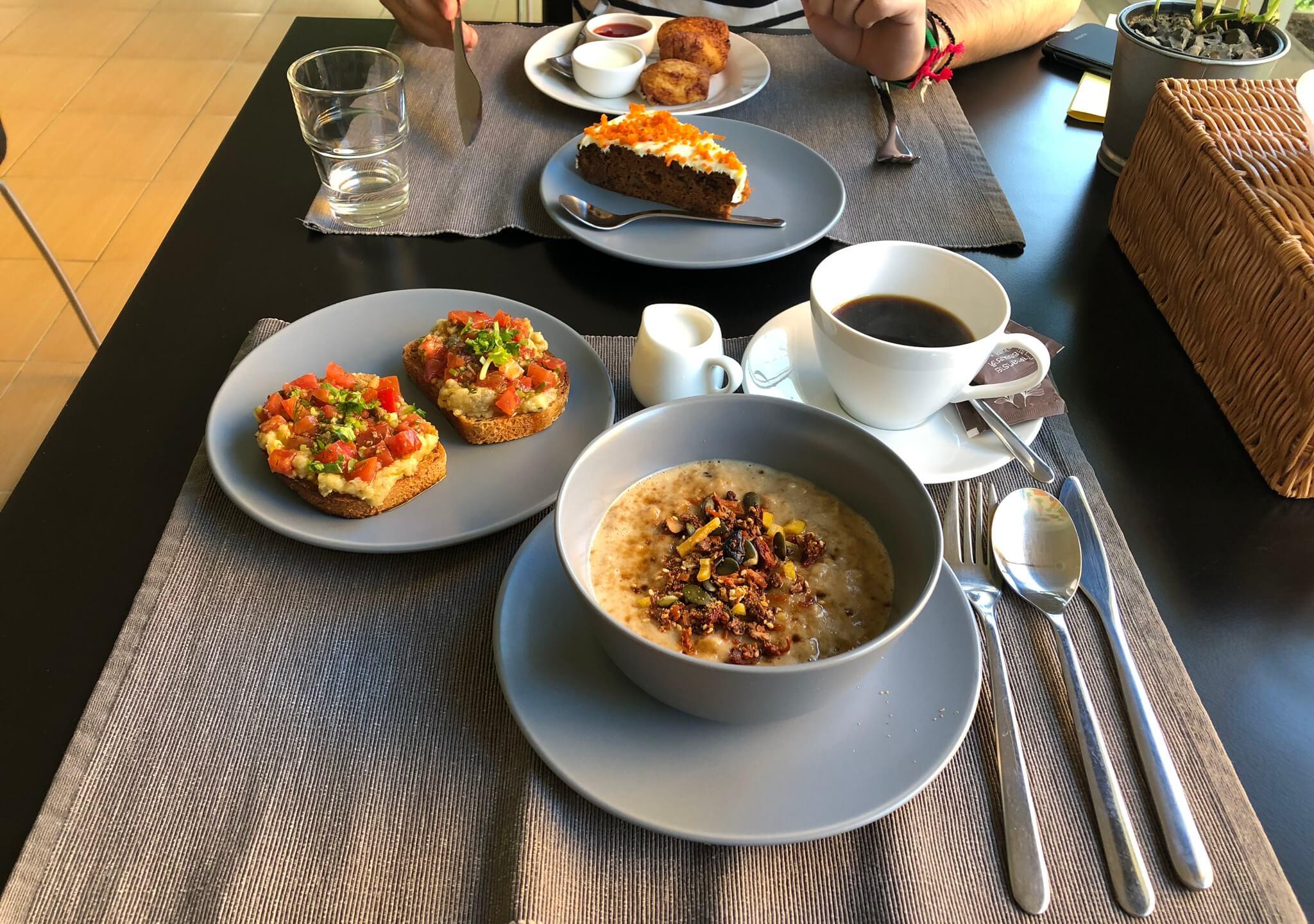 Vegan breakfast with porridge, avocado toasts and cake
