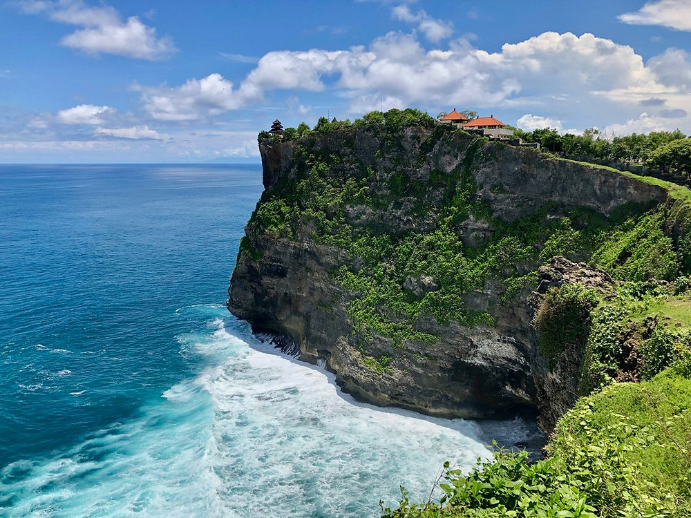 High cliffs in lush green and with view of the ocean