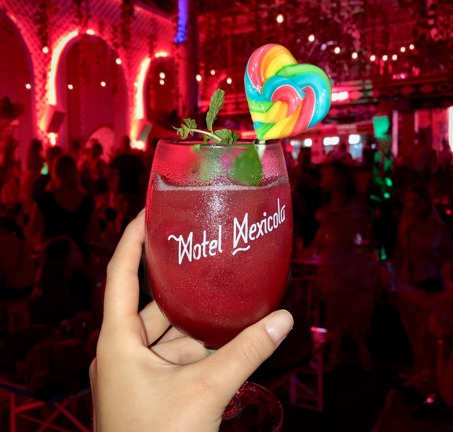 Colourful cocktail with a lollipop