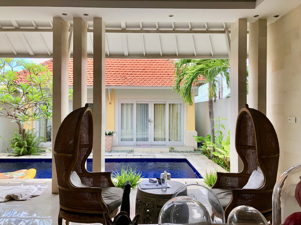Lounge area with chairs and pool view