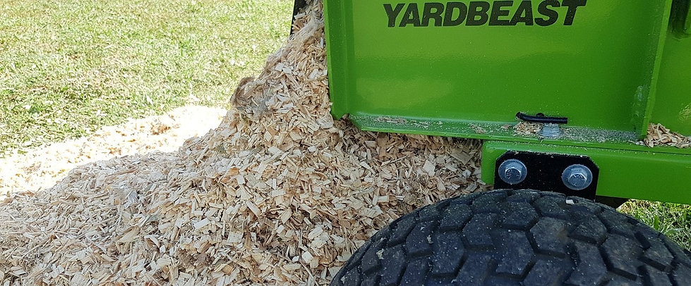 wood chips coming out of a wood chipper shredder