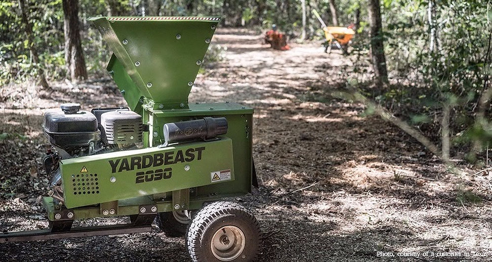 A wood chipper shredder being used to clear a trail in Texas