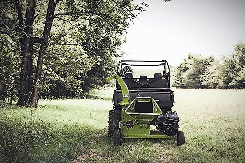 All terrain vehicle towing a 3514 wood chipper available at home depot