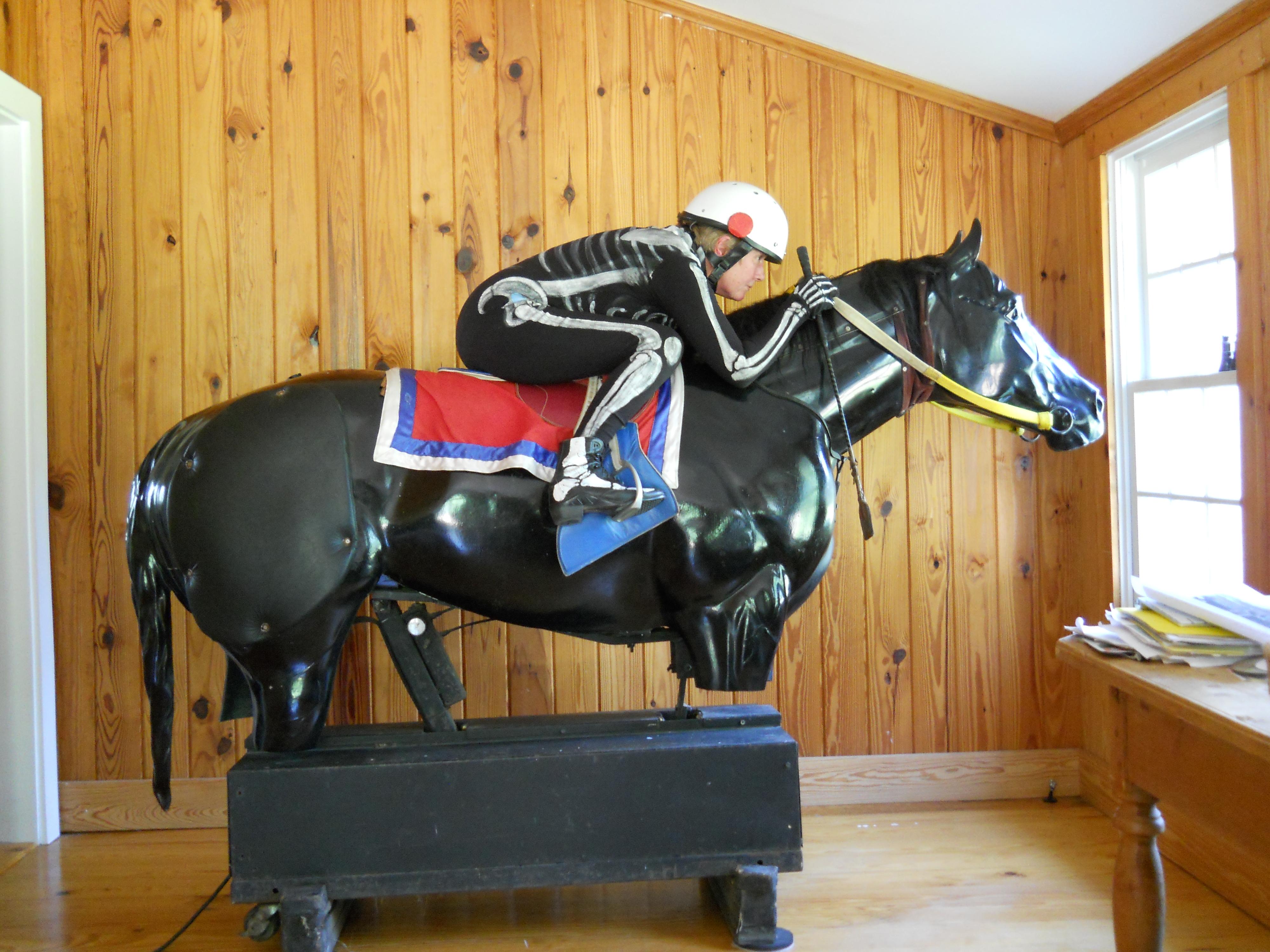 Peggy on mechanical horse.jpg