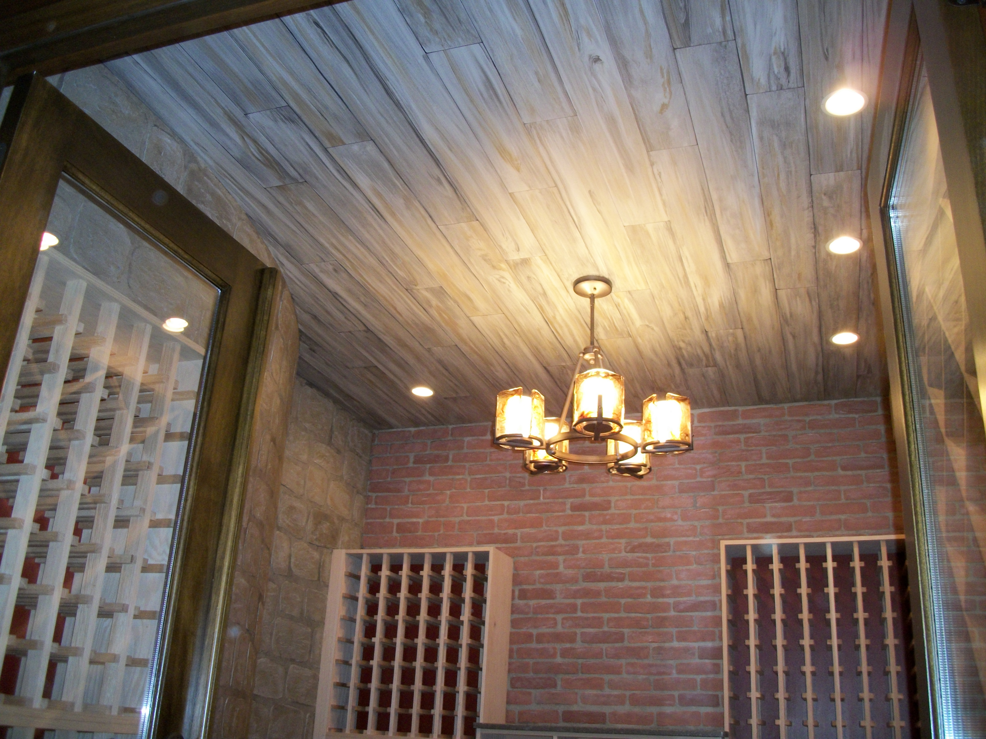 Faux barn wood ceiling, with faux brick & stone walls.