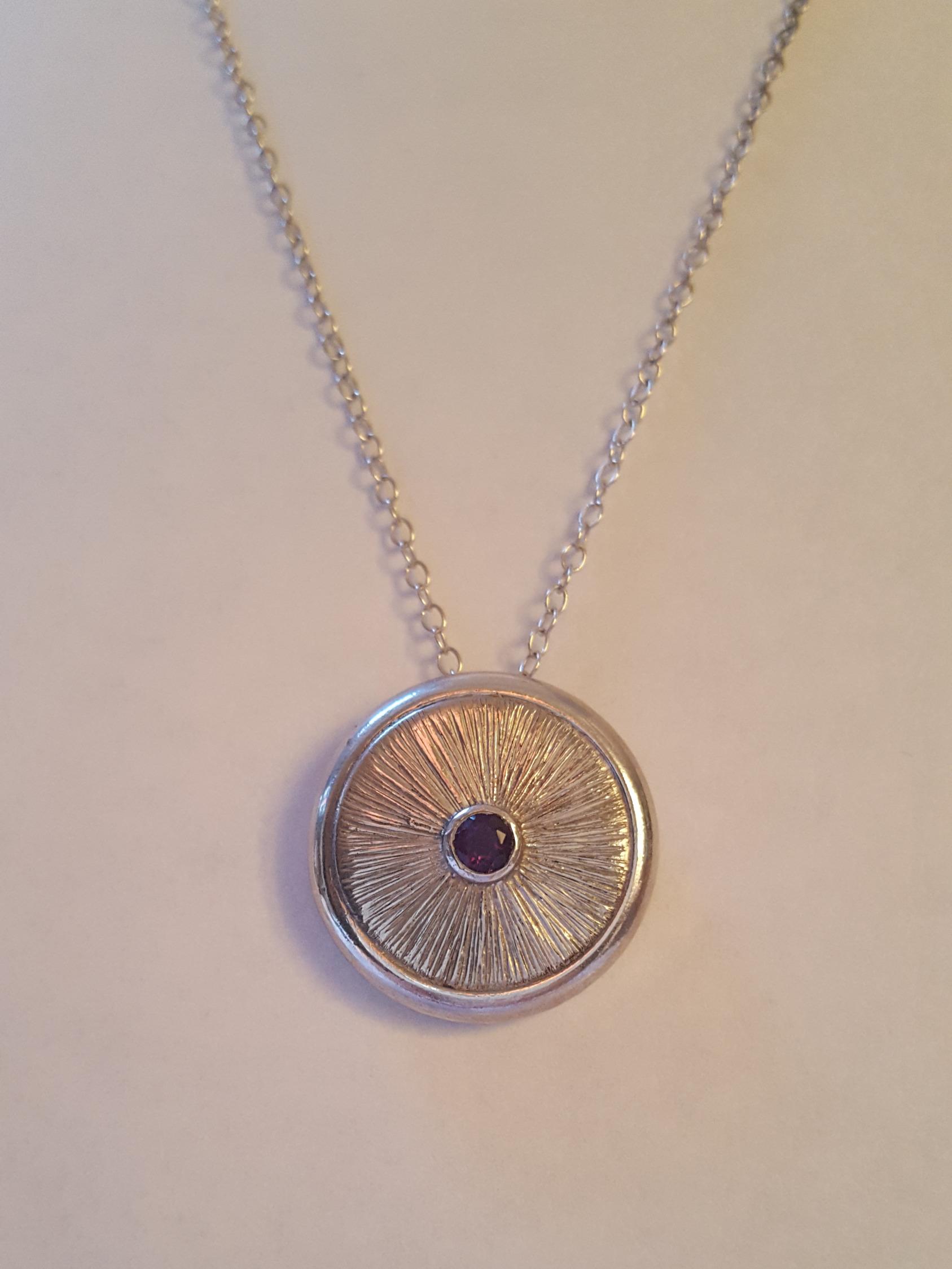 Engraved amethyst pendant