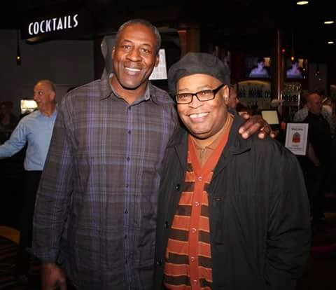 """Lomas Brown, left, posing with """"The Reel Hustler"""""""