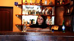 Mariia Lutsak, acting as bartender