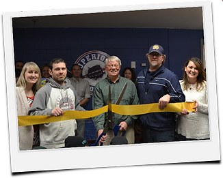 Katie Beerman, Dan Beerman, Scott, Nevenhoven, and Kasha Nevenhoven at Superior Hockey's ribbon cutting