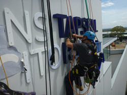 Abseiling sign installation