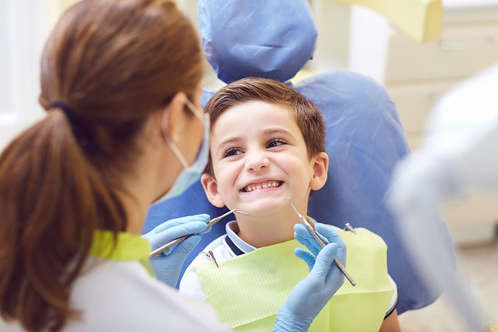 A child with a dentist in a dental offic