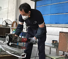 Man working on a piece of lead