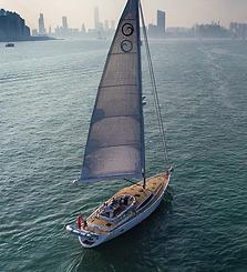 Kraken boat sailing towards a city
