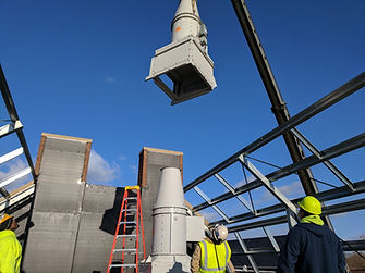 One of Dual Temp's experienced workers oversees HVAC equipment installation during new commercial construction in Lehigh Valley