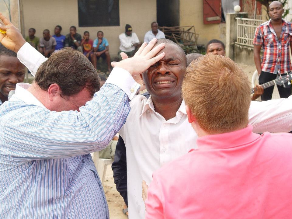 Warren Hunter ministering to the sick- Sword Ministries International