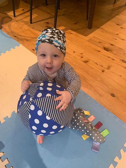 Baby_Holding Large Balloon Ball.jpg