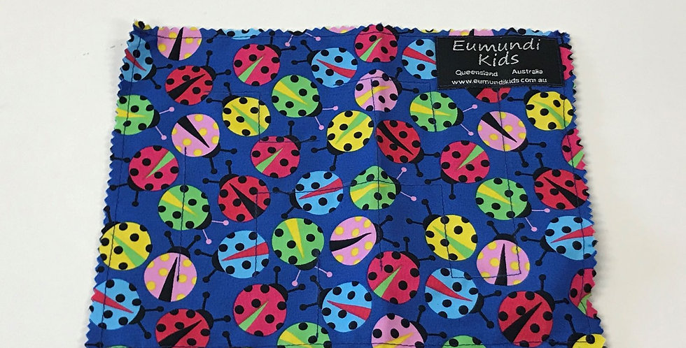 Marble Maze - Coloured Lady Bugs on Blue with Hot Pink Backing
