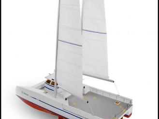 Un catamaran de travail à poussée vélique cat-boat