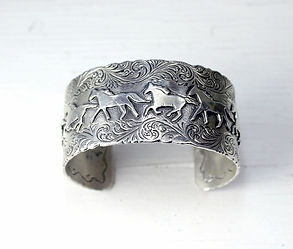 Sterling silver engraved styles of cuff bracelets, links or charms with south west motifs.