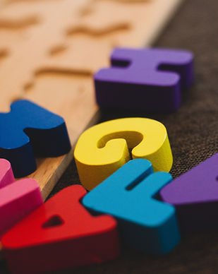 Using alphabet blocks during Occupational Therapy OT