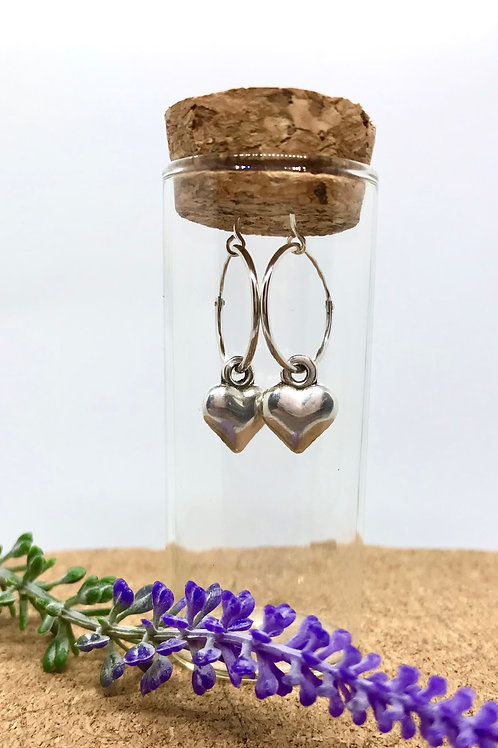 Sterling silver hoop with a heart charm in a bottle
