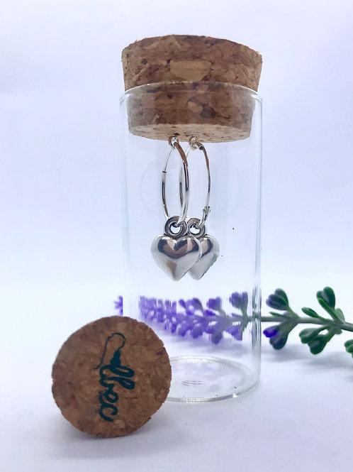 Sterling silver hoop with heart in a bottle