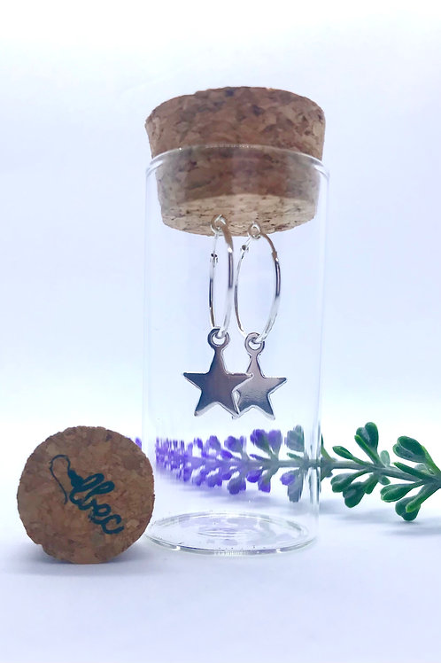Sterling silver hoops with star in a presentation bottle