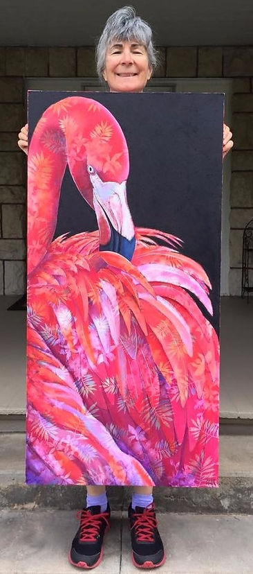 "Ande Hall holding a large flamingo painting, ""Flaming-Oh!"""