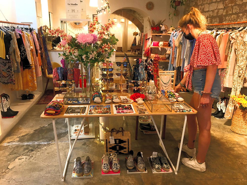 A person shopping in Barcelona for espadrilles at Le Studio