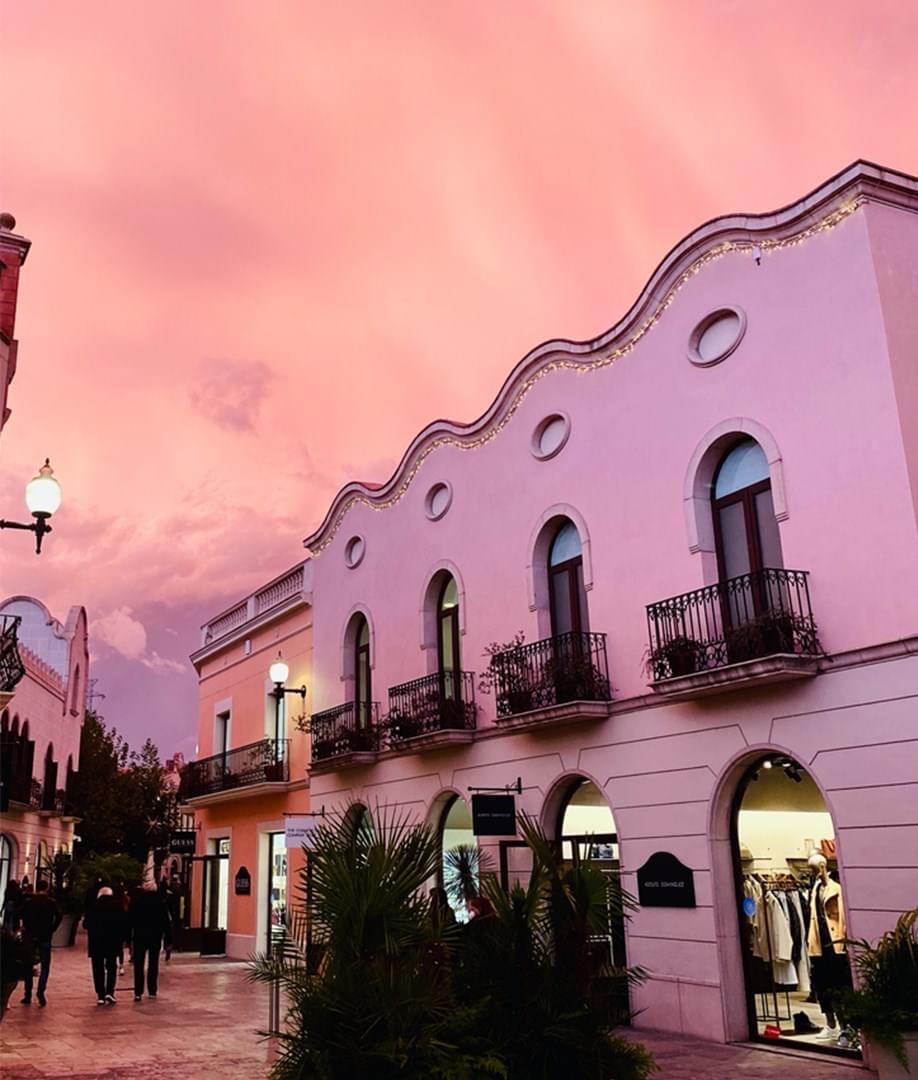 Designer outlet shopping near Barcelona at La Roca Village during sunsetduring sunset