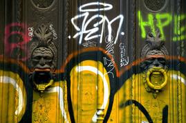 Graffiti-on-a door-in-Barcelona.jpg