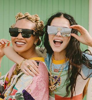 two women in designer clothes.JPG