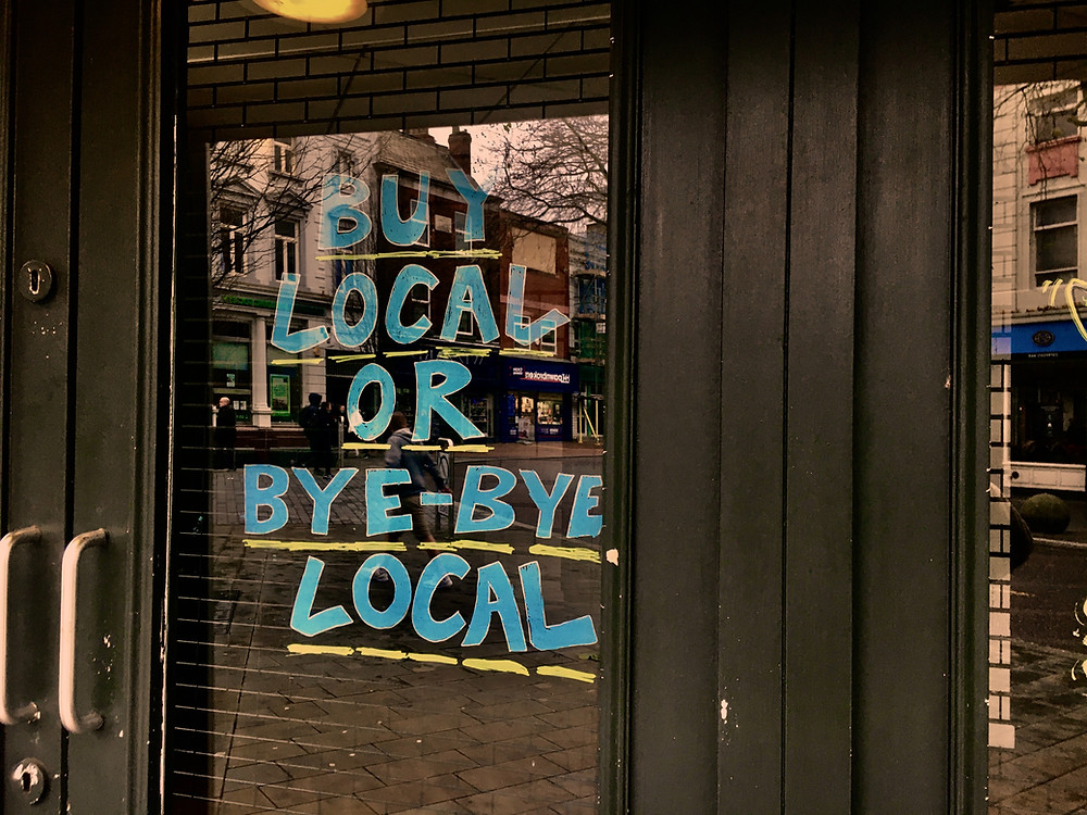 Buy local or bye-bye local shop sign