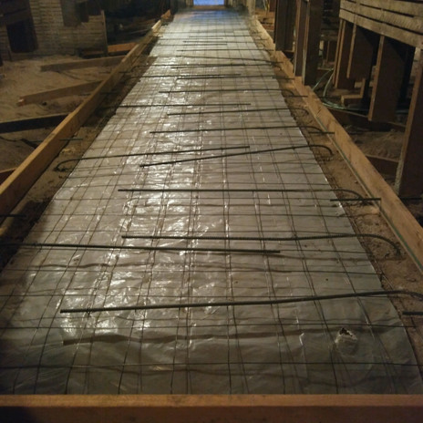 First Floor - Rebar from footers bent to reinforce hallway for pour.